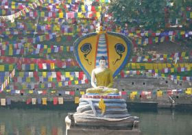 Muchalinda Sarovar at Bodhgaya, showing Lord Buddha in meditation, sheltered from rain by Snake King Muchalinda