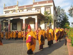 Khenpo and nuns performing circumambulation