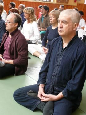 Students practicing meditation in Italy