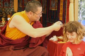 A Greek student taking refuge with Ven. Lama Dondrup Dorje