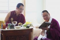 Ven. Lama Dondrup Dorje showing HH Karma Kuchen Rinpoche content on the iPad