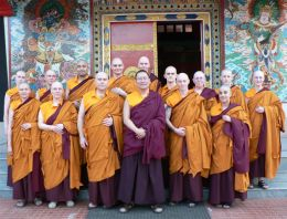 Lama Dondrup Dorje with newly ordained students in front of the Zangdokpelri Temple at Namdroling