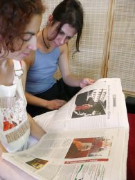 Two Cypriot students who attend the Pathgate Dharma Centre in Athens read the newspaper article about Thubten Dawa Loday