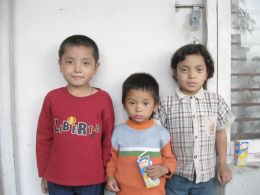 Three of the children sponsored by the Pathgate Partnership Programe to go to school in Nepal