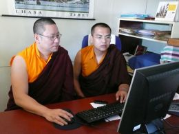 Lama Dondrup Dorje (left) and Lopon Phuntsho Gyeltshen (right) working together at Namdroling Monastery