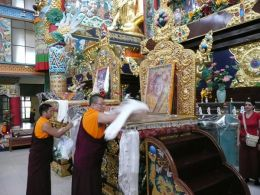 Ven. Lama Dondrup Dorje offerings khata at the thone of HH Penor Rinpoche during the mandala offering