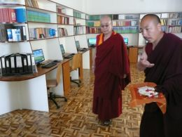 Lopon Jigmed Namgyal, the Project Manager of the Shedra Construction project, guiding Khenchen Pema Sherab through the Rinchen Terzod Editorial Committee Room