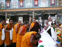 Ven. Lama Dondrup Dorje overseeing the offering of khatas to the Kudung of HH Penor Rinpoche by members of the Monastic Sangha of Namdroling Monastery
