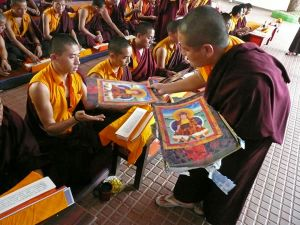 Thangkas of the late Holiness Penor Rinpoche being distributed to the Monastic Sangha at Namdroling Monastery