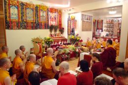 Ven. Lama Dondrup Dorje leads the Palyul Sangha in prayer before the shrine that features the thangka of His Holiness Penor Rinpoche