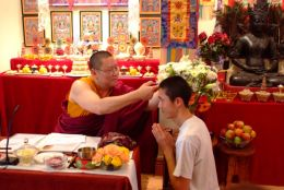 Ven. Lama Dondrup Dorje performed hair cutting ritual on a Japanese student during ceremony of Taking Refuge