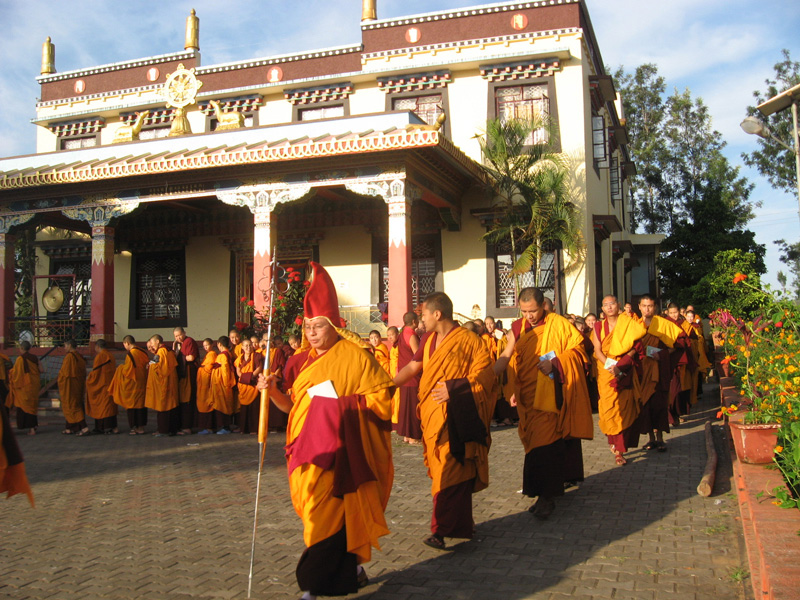 Khenpo Tsultrim Tentar leading a procession of staffs and students on the last day of the school term at Ngagyur Tsogyal Sherupling Nunnery.