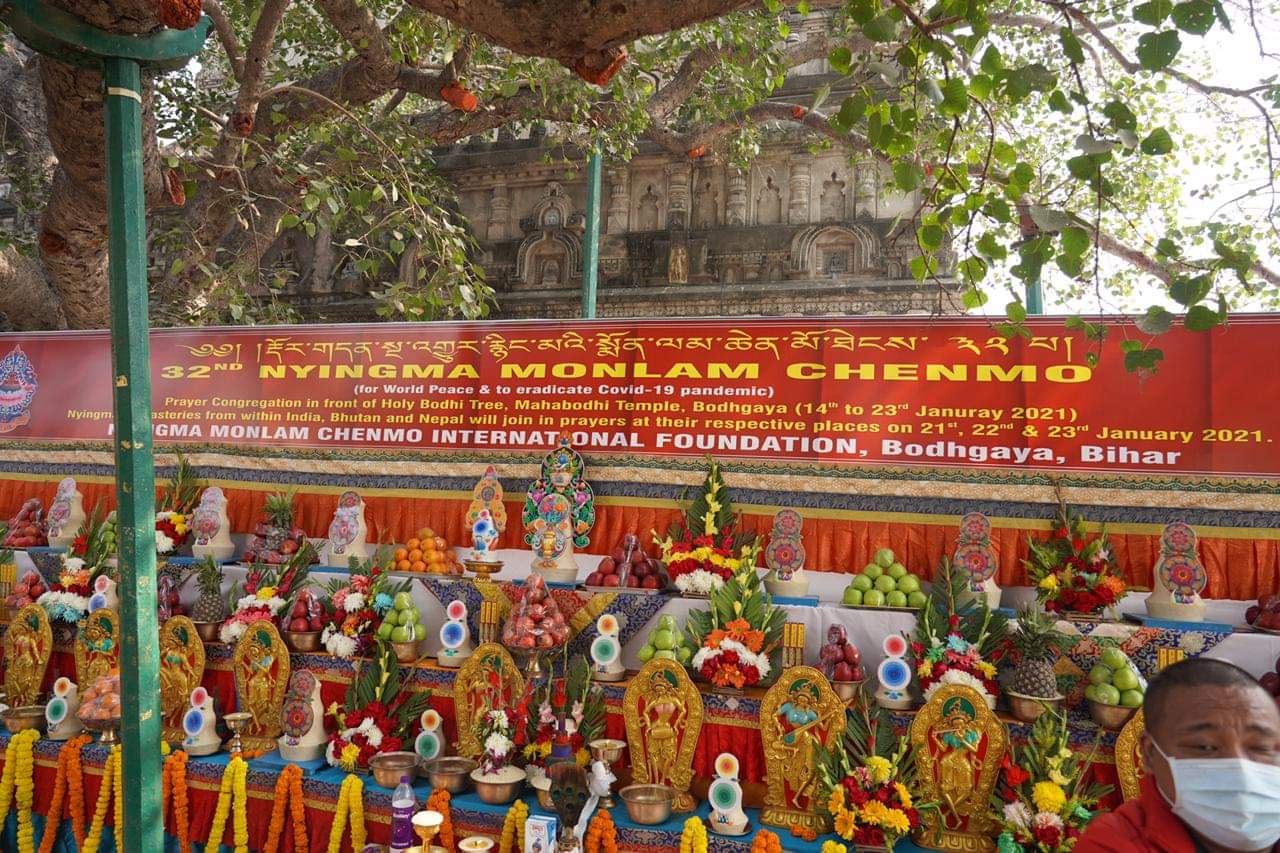 Offering of Torma, flowers and fruit before the Bodhisattva tree of the Mahabodhi Temple