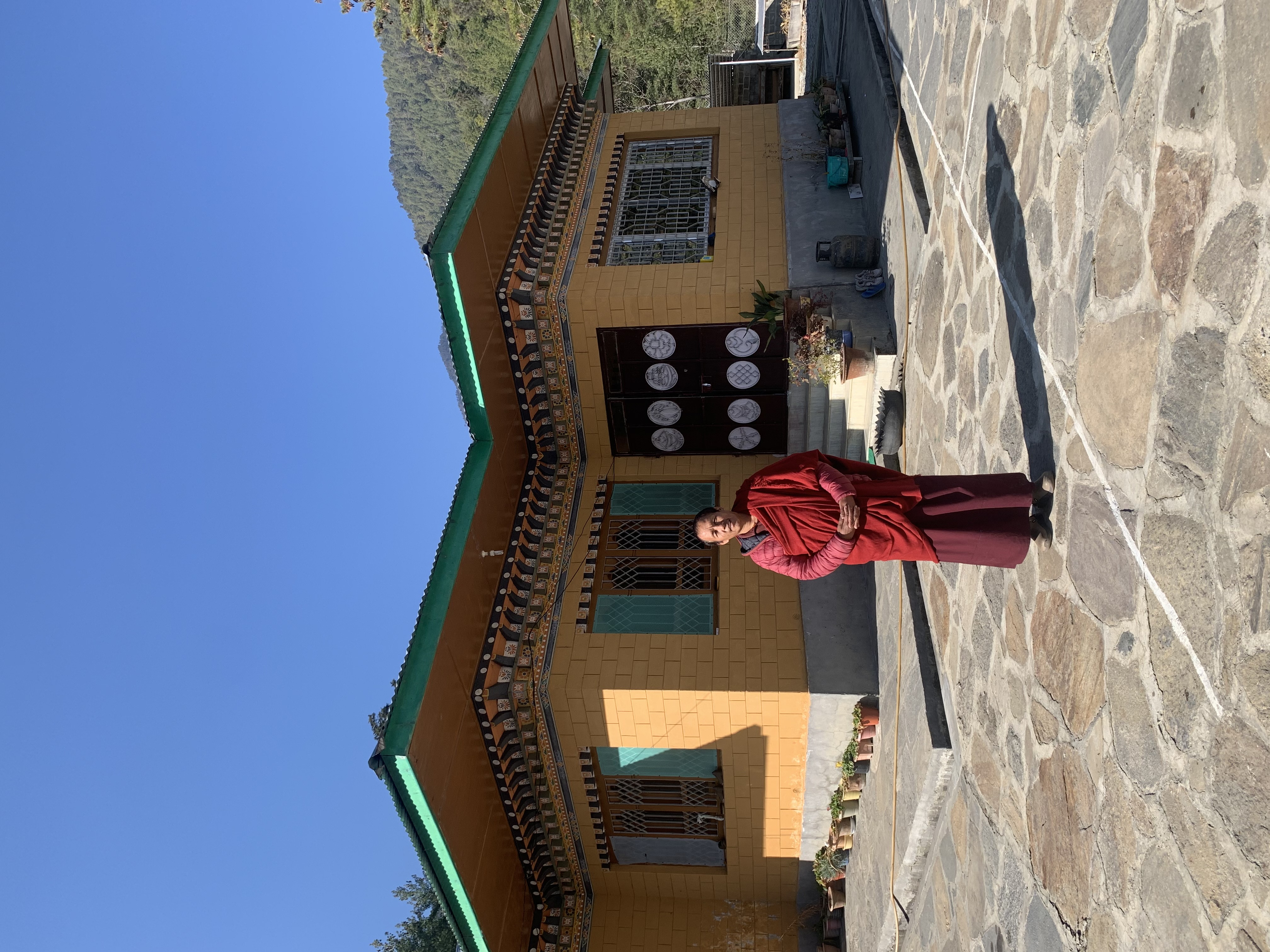 Khenpo Sangay Wangdi Rinpoche in front of his retreat house