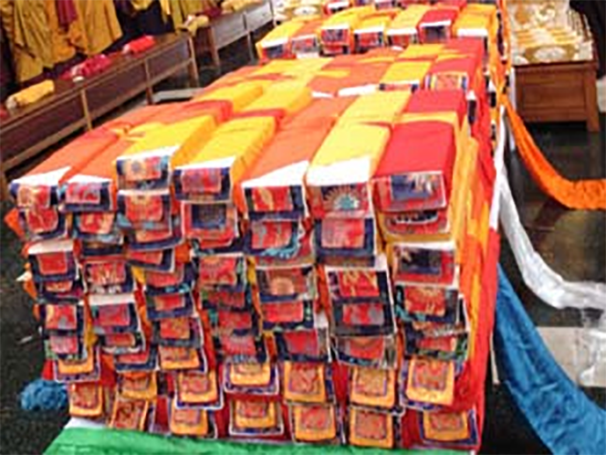 A full set of Kangyur procured by Lama Dondrup Dorje Rinpoche from Tibet as an offering to HH Pema Norbu Rinpoche at HH's Long Life Puja in India