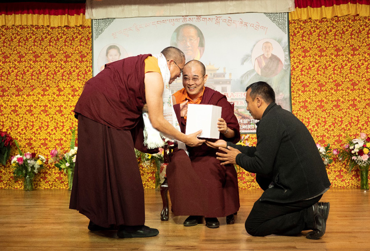 Lama Dondrup Dorje Rinpoche receiving the gift of a One Hundred Deity Torma from Chogtrul Gyangkhang Rinpoche
