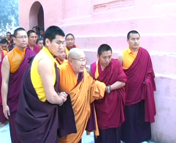 HH Penor Rinpoche in Bodhgaya, India, with Lama Pasang and Lama Dondrup Dorje Rinpoche working as attendants during Monlam Chenmo Prayer Festival
