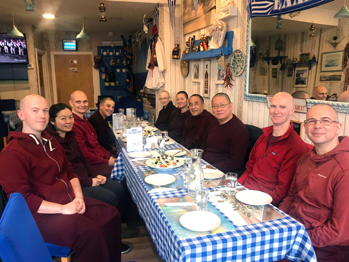 Khenpo Nyima Dondrup Rinpoche eating with Lama Dondrup Dorje Rinpoche and members of the Pathgate sangha