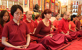 Students practice meditation