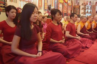 Retreatants practise meditation