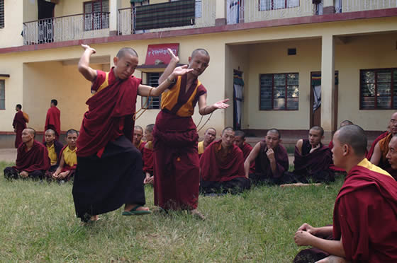 Monks practising tradional debating